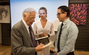 Eduardo Salcedo gives his book to Fernando Henrique Cardoso